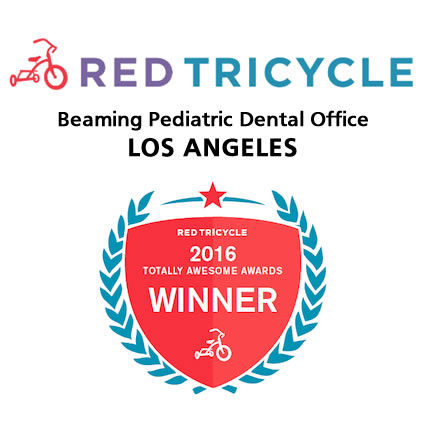 Red Tricycle Beaming Pediatric Dental Office